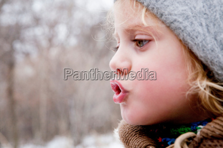 little girl looking at her breath