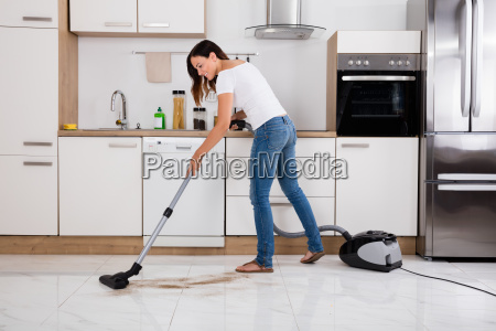 woman cleaning the dust floor of