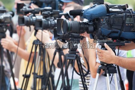 video camera operators working at press