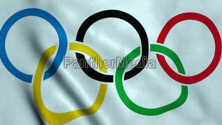 sventolando la bandiera dei giochi olimpici