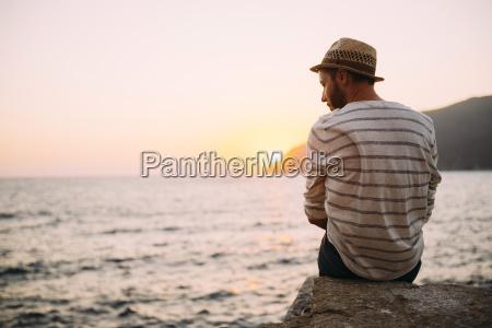 greece cylcades islands amorgos man sitting