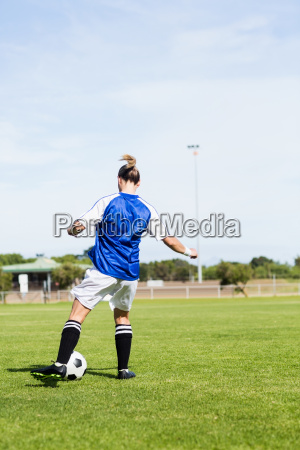 rear view of female football player