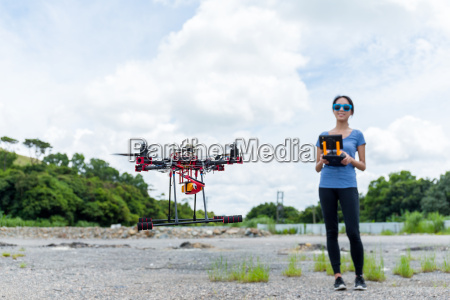 young woman control with drone