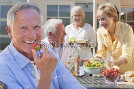 group of senior friends enjoying outdoor