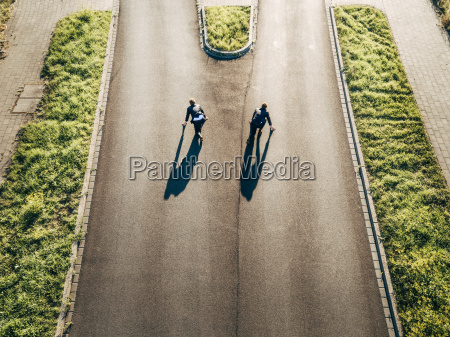 two businessmen starting race on road