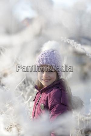 portrait of happy girl wearing bobble