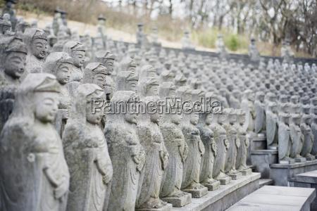 statues gwaneumsa buddhist temple jeju island