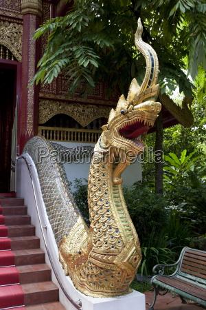gilded dragon outside wat phra kaew