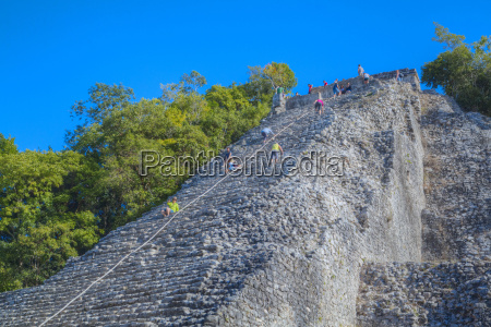 tourists climbing the temple nohoch mul