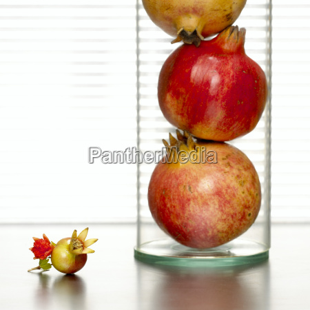 pomegranates in glass