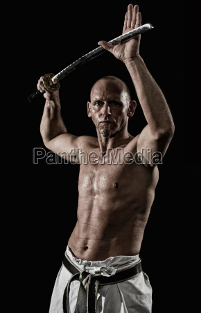 germany bavaria mature man doing karate