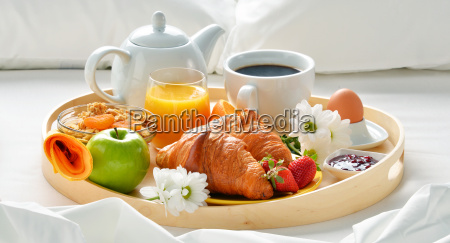 breakfast tray in bed in hotel