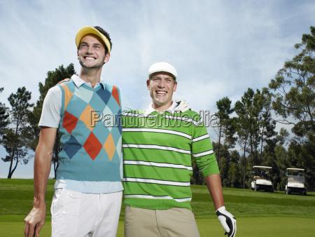 men with arm around at golf