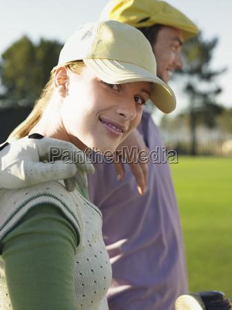 female golfer with friends on golf