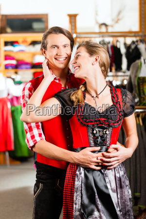 couple is trying dirndl or lederhosen