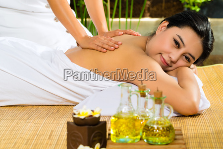 asian woman having a massage in