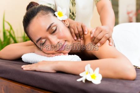 indonesian asian woman at wellness massage