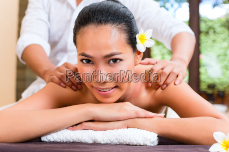 indonesian asian woman at wellness massage