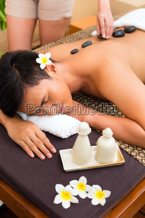 indonesian man at hot stone wellness