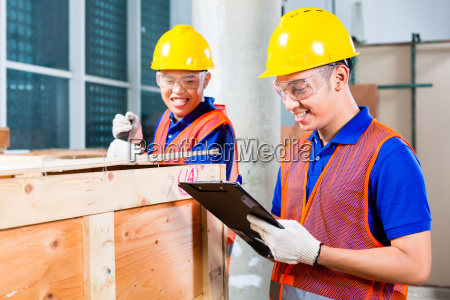 asian construction workers on site open
