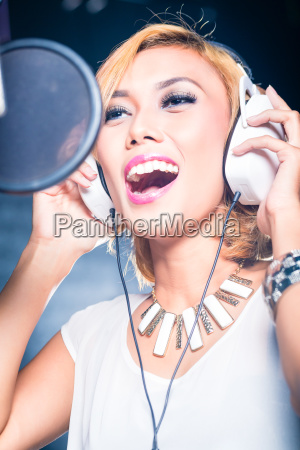 asian, singer, producing, song, in, recording - 21484723
