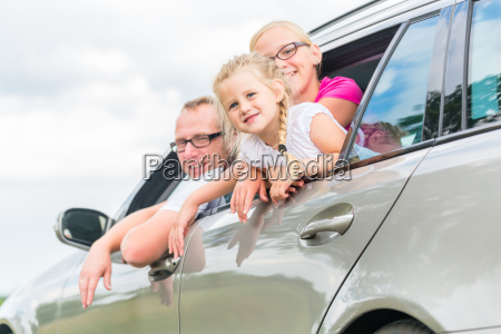 family driving by car in summer
