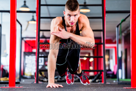 man doing push up in sport