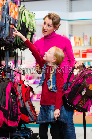 family buying school satchel or bag