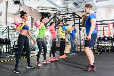 men and women with coach at