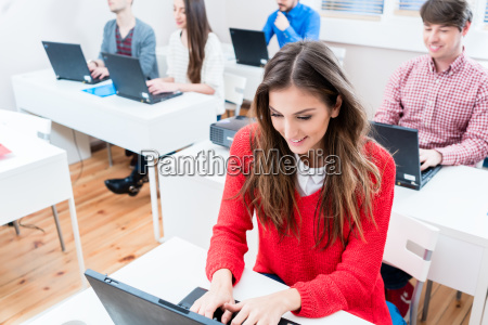 student woman working on laptop pc