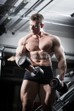bodybuilder in gym at fitness training
