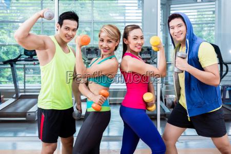 sportsmen and sportswomen executing functional training