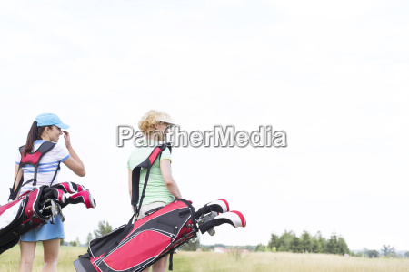 rear view of women with golf
