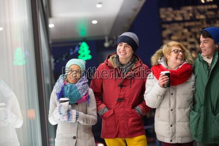 happy multiethnic friends in winter wear