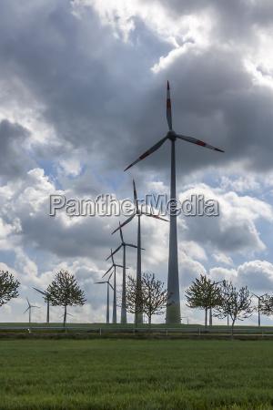 dark clouds over wind turbines
