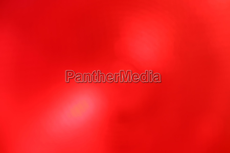 red abstract blur background with lens