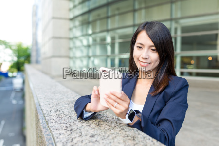 asian business woman working on cellphone
