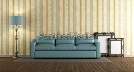sofa di cuoio blu in un