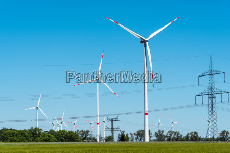 power lines and wind turbines in