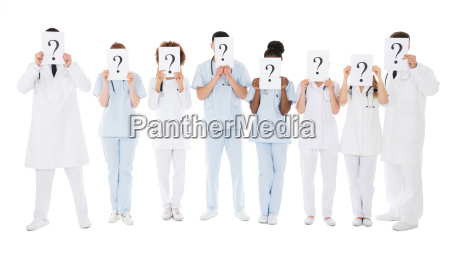 group of multiracial doctors hiding behind