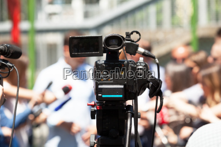 press or news conference filming media