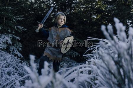 little boy wearing knight costume