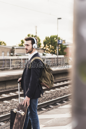 young man waiting on platform