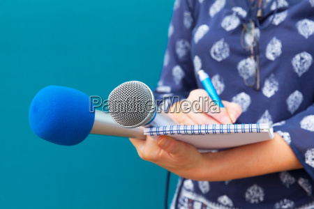 female journalist taking notes at press