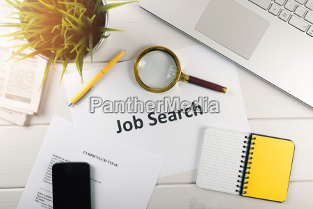 job search items on white table