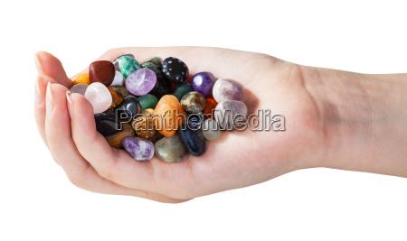 donna mano rilasciato colore femminile pietra