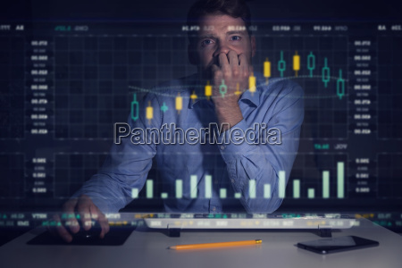 businessman analyzing stock market graphs and