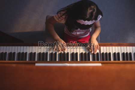 overhead view of elementary girl playing