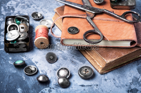 sewing accessories on a blue background