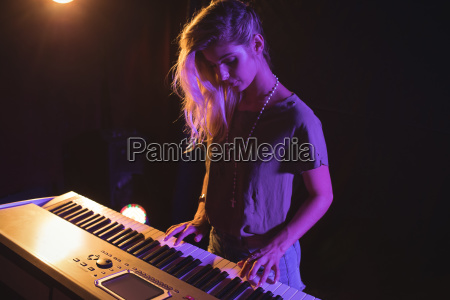 high angle view of female musician